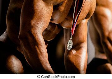 gold medal winner on man chest athlete