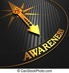 Awareness Concept - Golden Compass Needle on a Black Field Pointing.