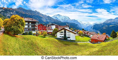 Awesome autumn view of picturesque alpine village Wengen.