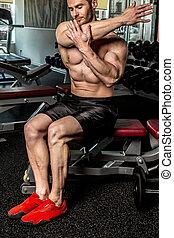 Awesome bodybuilder in a gym
