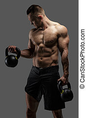 Awesome muscular guy with dumbell