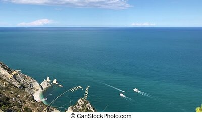Awesome view of motor boat sailing on the sea. View from the rock