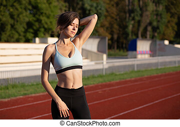 Awesome woman posing at the running track