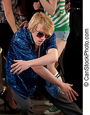 Awkward man dancing low at a 1970s Disco Music Party