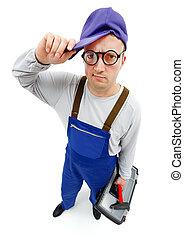 Awkward repairman - Wide angle view of an awkward repairman ...