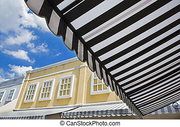 Awning over bright sunny blue sky