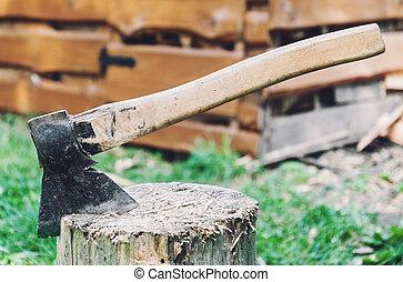 Axe in a log