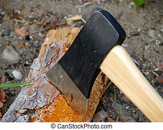 axe in firewood - axe blade chopping firewood