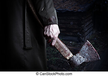 Axe with blood in male hand. murderer or butcher, halloween ...
