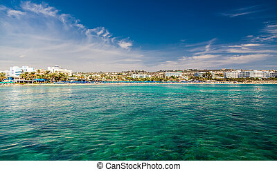 Ayia Napa town coastline with hotels and public beaches, ...