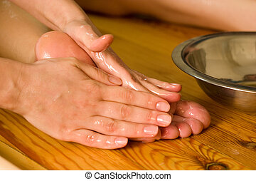 ayurvedic foot therapy massage procedure with oil