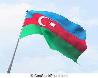 Azerbaijan flag flying on clear sky.
