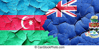 Azerbaijan flag with Cayman islands flag on a grunge cracked wal