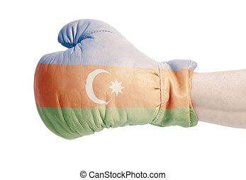 Azerbaijani flag on boxing gloves wearing in male hand