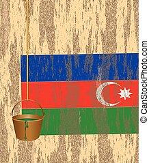 Azerbaijani flag on the wall of a ruined house