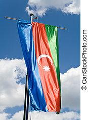 Azerbaijani flag over blue sky