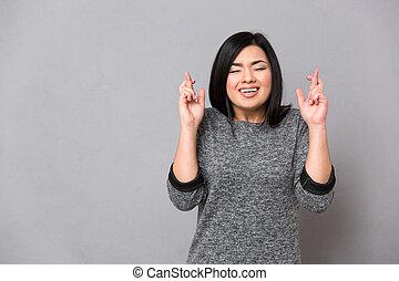 aziatisch meisje, het behouden, gekruiste vingers, en, ogen...