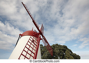 Azores traditional red and white windmill in Sao Miguel. Portugal