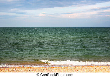 Azov sea - Turquoise waters of a golden sand beach with blue...