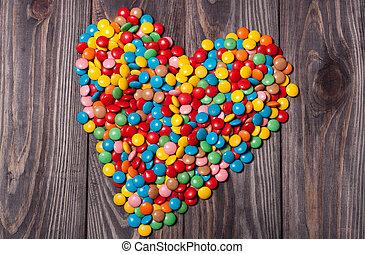 azucare corazones, en, madera, día de valentines, plano de fondo