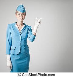 azul, cinzento, apontar, vestido, uniforme, stewardess, fundo, charming, dedo