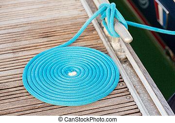 azul, corda, enrolado, ligado, um, madeira, doca
