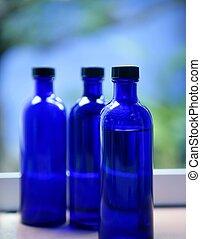 azul, grasa natural de la piel, botellas, tres, vidrio