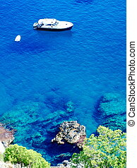 Azure sea at Capri island - Aerial view of Capri island with...