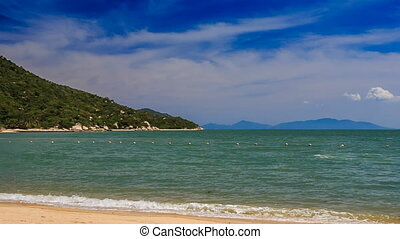 azure sea wave surf on golden beach on Vietnamese island -...
