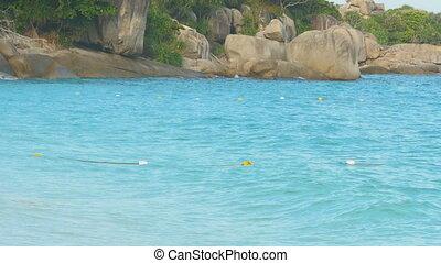 Azure water Similan Islands - Turquoise sea water waves,...