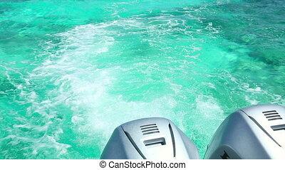 Azure water - Wake from a speedboat outboard motor