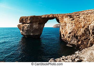 Azure Window, famous stone arch of Gozo island in the sun in summer, Malta