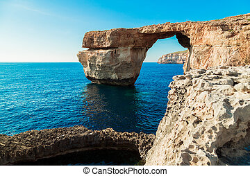 Azure Window, famous stone arch of Gozo island in the sun in summer, Malta
