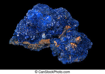 Azurite is a soft, deep blue copper mineral produced by weathering of copper ore deposits. Isolated in black background.
