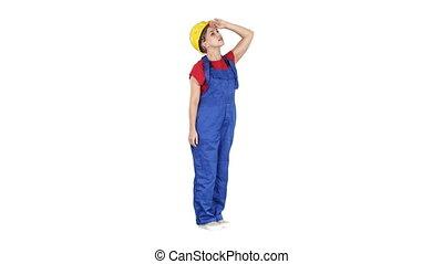bâtiment, casque, femme, graphique, haut, jaune, regarder, arrière-plan., statistiques, blanc, ou, stupéfié, ingénieur