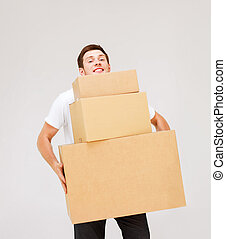 bärande lådor, kartong, ung man