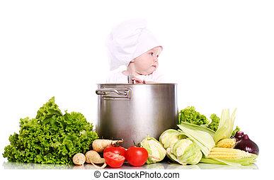 L gumes b b cuisinier table assied cuisine photo de for Cuisinier 3 etoiles legumes