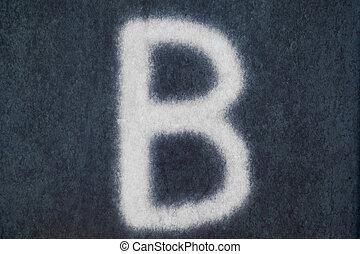B isolated chalk letter in blackboard background