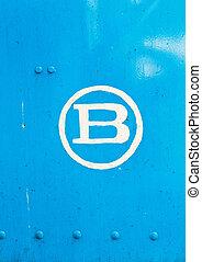 b letter in blue metal