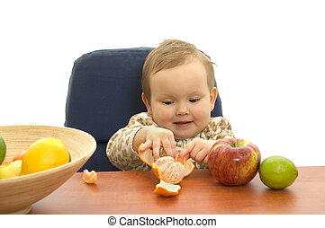Babby eating fruit