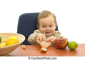 Babby eating fruit