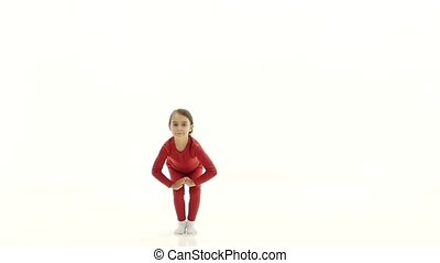 Babe jumps up and has fun in the spacious room. White background. Slow motion