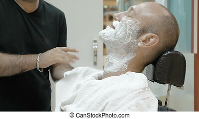 Baber or men's hair stylist wipes his hands - Baber or men's...