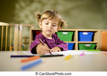 Babies and fun, child drawing at school - Little girl having...