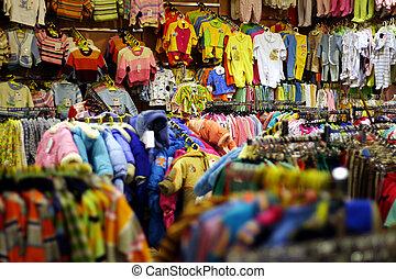 Babies clothes - Bright babies clothes department in shop