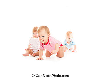 Babies crawling over white