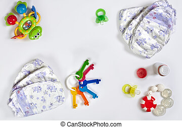 Babies goods diaper, soother or on white background with ...