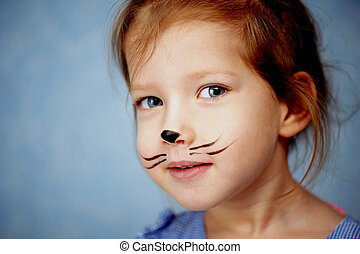 Baby 3 years with face painting of a cat, meowing and smiling looking at camera