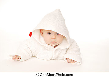 A baby in white hood
