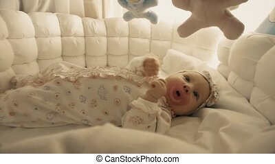 Baby about to sleep in the cradle - Newborn baby girl in her...